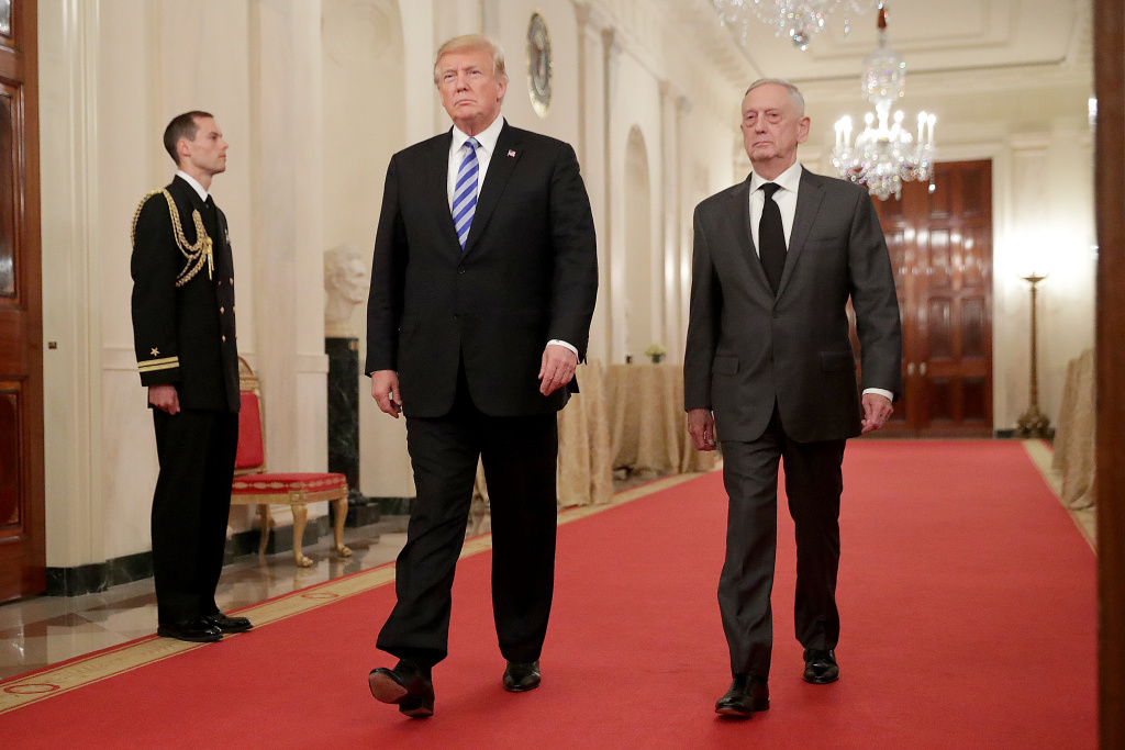 U.S. President Donald Trump (L) and Defense Secretary James Mattis arrive for an event commemorating the 35th anniversary of attack on the Beirut Barracks in the East Room of the White House October 25, 2018 in Washington, DC.
