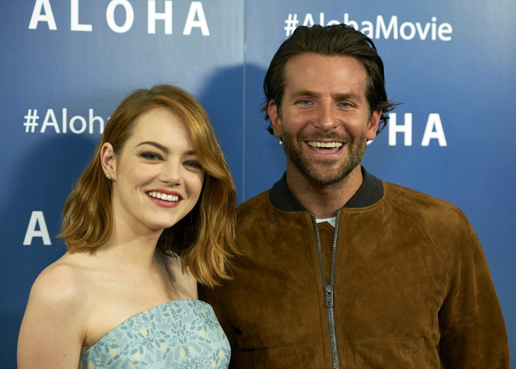 US actors Emma Stone (L) and Bradley Cooper (R) pose together arriving to attend a special screening of the film Aloha in London on May 16, 2015.