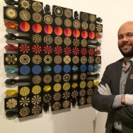 Edward Hayes, Jr., curator of exhibitions at the Museum of Latin American Art in Long Beach, stands next to a work by Pedro Friedberg.