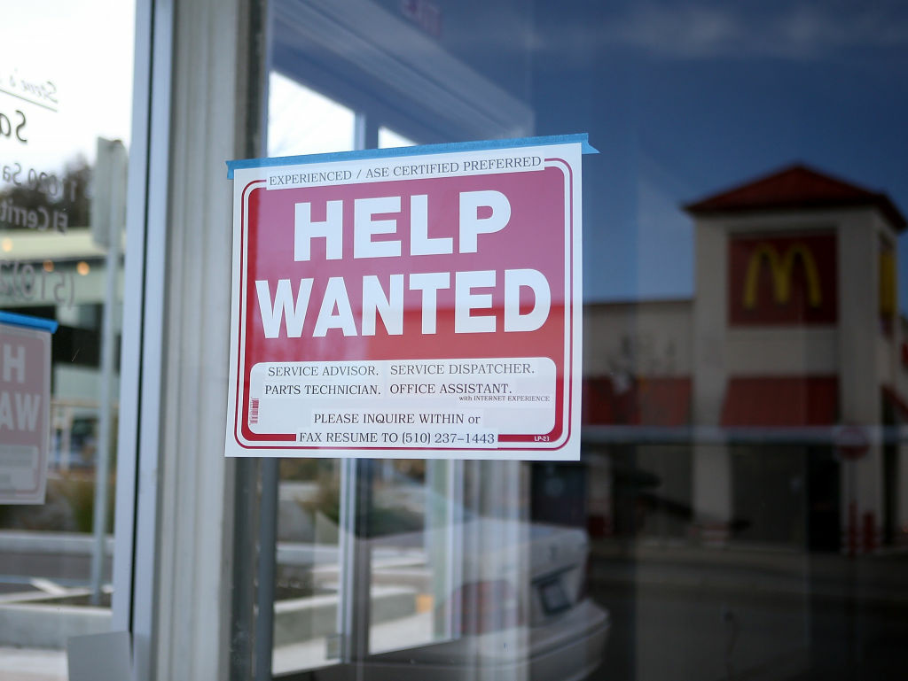 The number of Americans seeking unemployment aid fell last week to seasonally adjusted 324,000, the lowest since January 2008. The drop points to fewer layoffs and possibly more hiring.The Labor Department says weekly applications fell 18,000, the second straight sharp drop. (Photo: Help wanted sign at an auto shop in El Cerrito, Calif.)