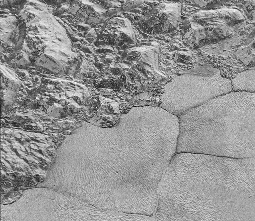 Pluto's shoreline of Sputnik Planum is seen in the highest-resolution images yet to come from New Horizons. John Spencer of the Southwest Research Institute says the details support the idea that the mountains