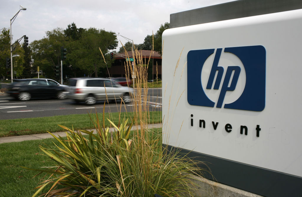The HP logo is displayed on the entrance to the Hewlett-Packard Headquarters September 16, 2008 in Palo Alto, California. Hewlett-Packard has announced it is splitting in two.