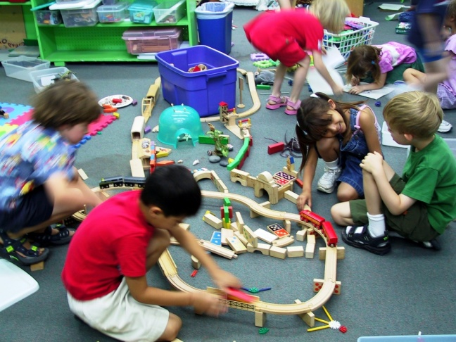 Kindergarten students at the Children's Community School in Van Nuys play with blocks and random objects during a period of free play. It's part of the school's