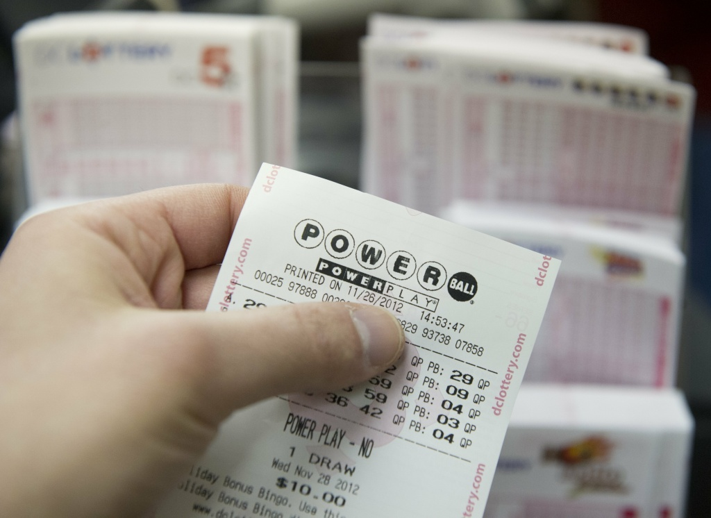 A Powerball lottery ticket for the estimated record 425 million USD jackpot prize, Powerball's biggest winnings ever, is seen in a convenience store in Washington on November 26, 2012. Today California becomes the 43rd state to join the Powerball lottery.
