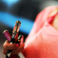A woman tries electronic cigarettes at a store in Miami.