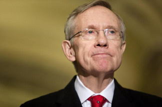 Senate Majority Leader Harry Reid (D-NV) pauses while speaking after a meeting with President Barack Obama and other Senate Democrats on Capitol Hill December 6, 2009