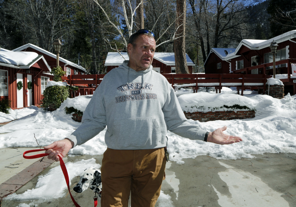 Rick Heltebrake, 61, a Boy Scout camp ranger, describes Wednesday, Feb. 13, 2012, how fugitive Christopher Dorner hijacked his pickup truck while attempting to flee from the Big Bear area Tuesday at his camp in Angelus Oaks in the San Bernardino National Forest. Heltebrake said Dorner told him he didn[t want to hurt him, or his 4-year-old Dalmation Suni, he just wanted his truck.  Heltebrake complied, and Dorner took the truck.