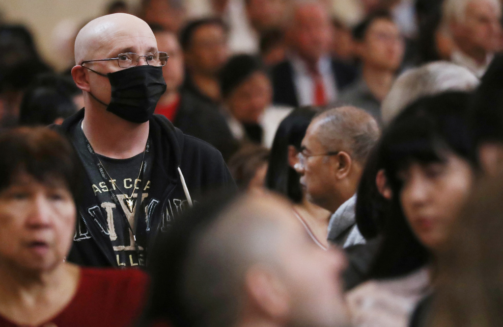 A worshipper wears a face mask to protect against the coronavirus while sitting in a pew at the Cathedral of Our Lady of the Angels on Ash Wednesday on February 26, 2020 in Los Angeles, California.