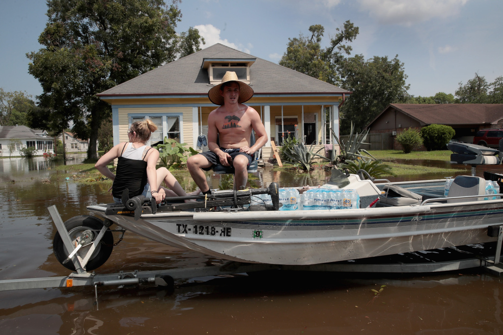 Volunteers pass out water to flood victims after torrential rains pounded Texas following Hurricane Harvey.