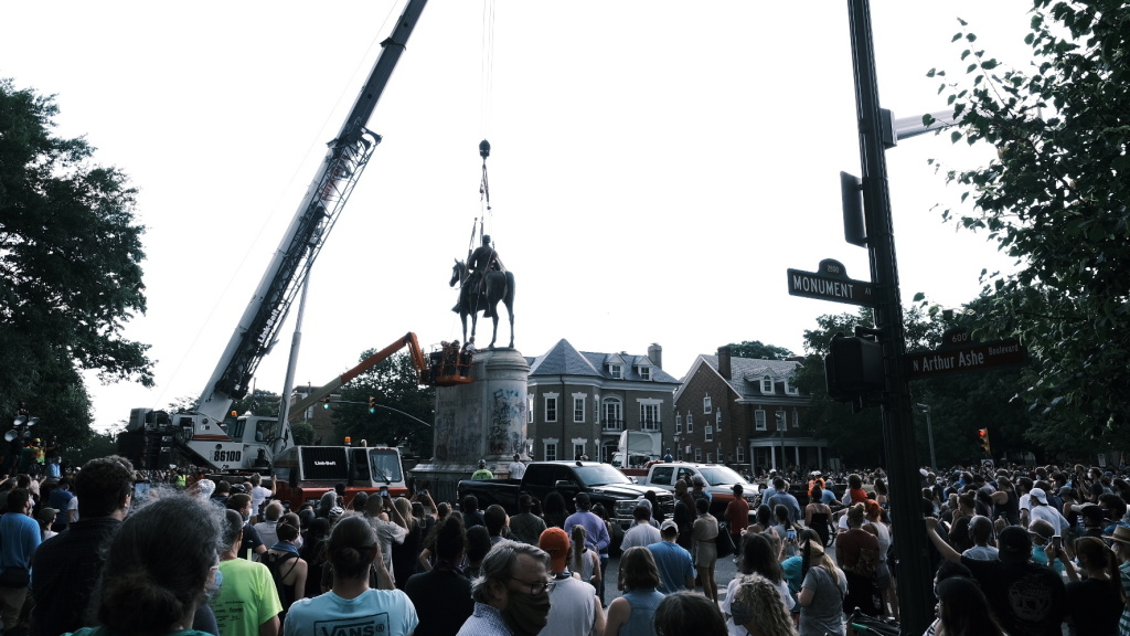 A crowd watches as a crane removes the Stonewall Jackson Monument in Richmond, Va., on July 1. Dozens of Confederate monuments have come down this summer.