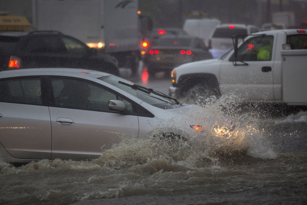 File: Drivers ford a flooded street as a powerful storm moves across Southern California on Feb. 17, 2017 in Sun Valley, California.