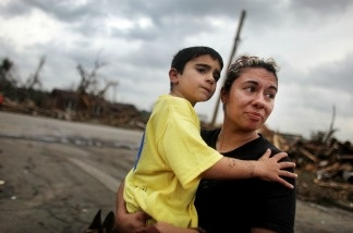 Kimmy Lankford holds her son Jack, 5, during a walk through their neighborhood after a massive tornado passed through the town killing at least 123 people on May 25, 2011 in Joplin, Missouri.