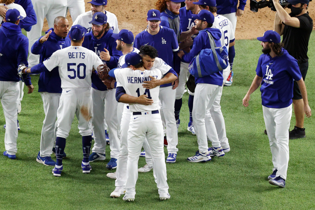 The Los Angeles Dodgers celebrate their 4-3 victory against the Atlanta Braves in Game Seven of the National League Championship Series at Globe Life Field on October 18, 2020 in Arlington, Texas.