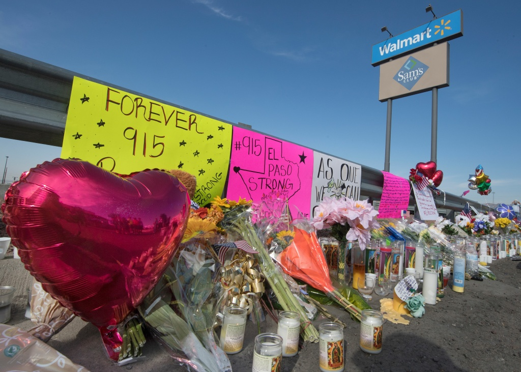 Flowers and signs at a makeshift memorial after the shooting that left 21 people dead at the Cielo Vista Mall WalMart in El Paso, Texas, on August 5, 2019