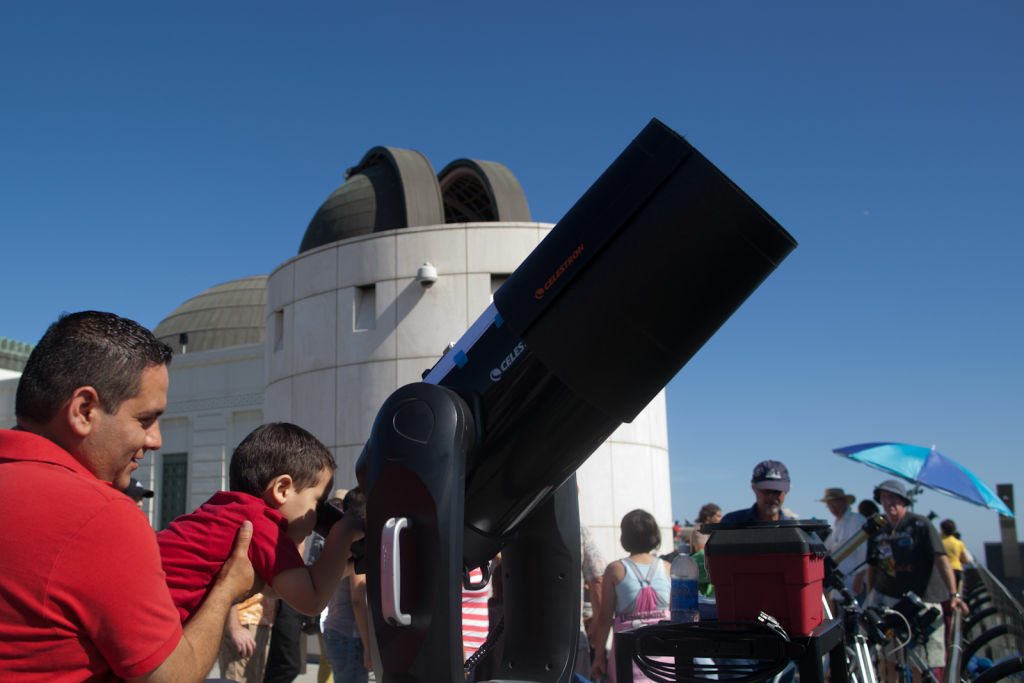 Justin, 4, takes a peak at the sun through a large telescope.