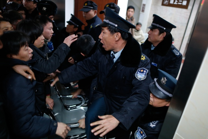 Angry family members clash with security personnel in a hospital  where some of the victims of a stampede by new year's revellers were sent in Shanghai on Jan. 1, 2015. A stampede by New Year's revellers in Shanghai's historic riverfront area killed 35 people and injured dozens more, the city government said Jan. 1.