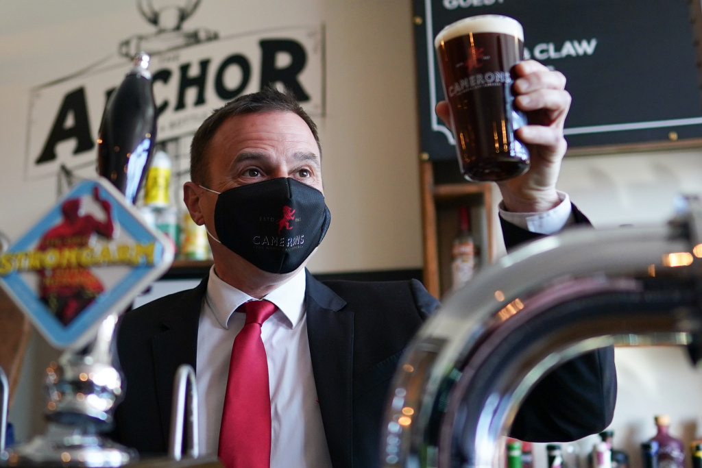 Dr Paul Williams, Labour Party candidate for Hartlepool pulls a pint during a visit to Cameron's brewery in Hartlepool on April 23, 2021 in Hartlepool, England.
