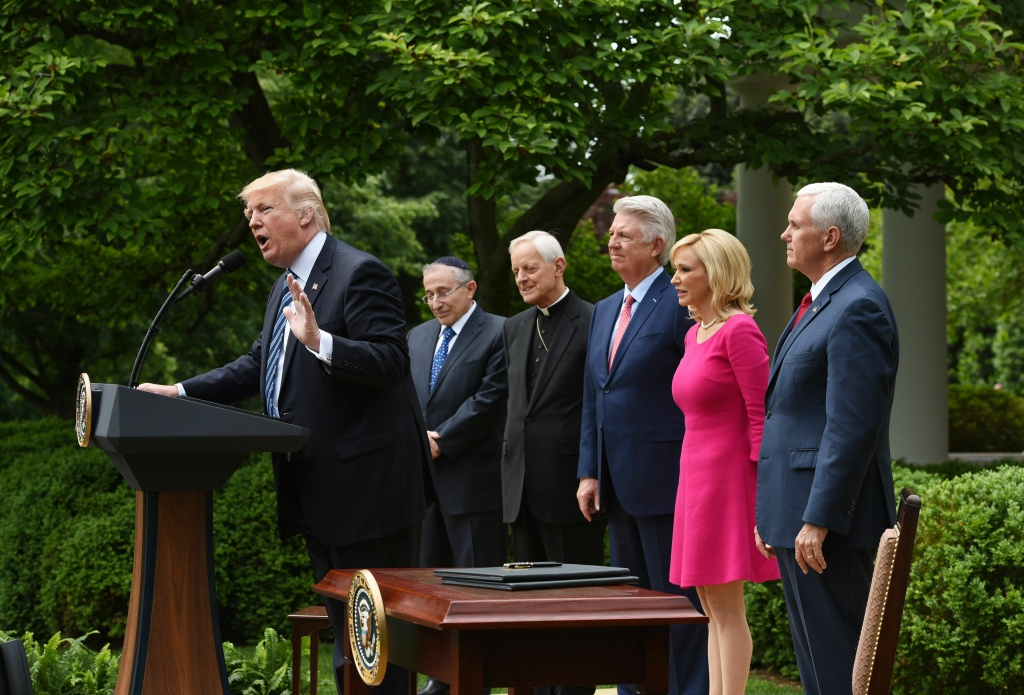 US President Donald Trump speaks before signing an Executive Order on Promoting Free Speech and Religious Liberty in the Rose Garden of the White House on May 4, 2017 in Washington, DC.