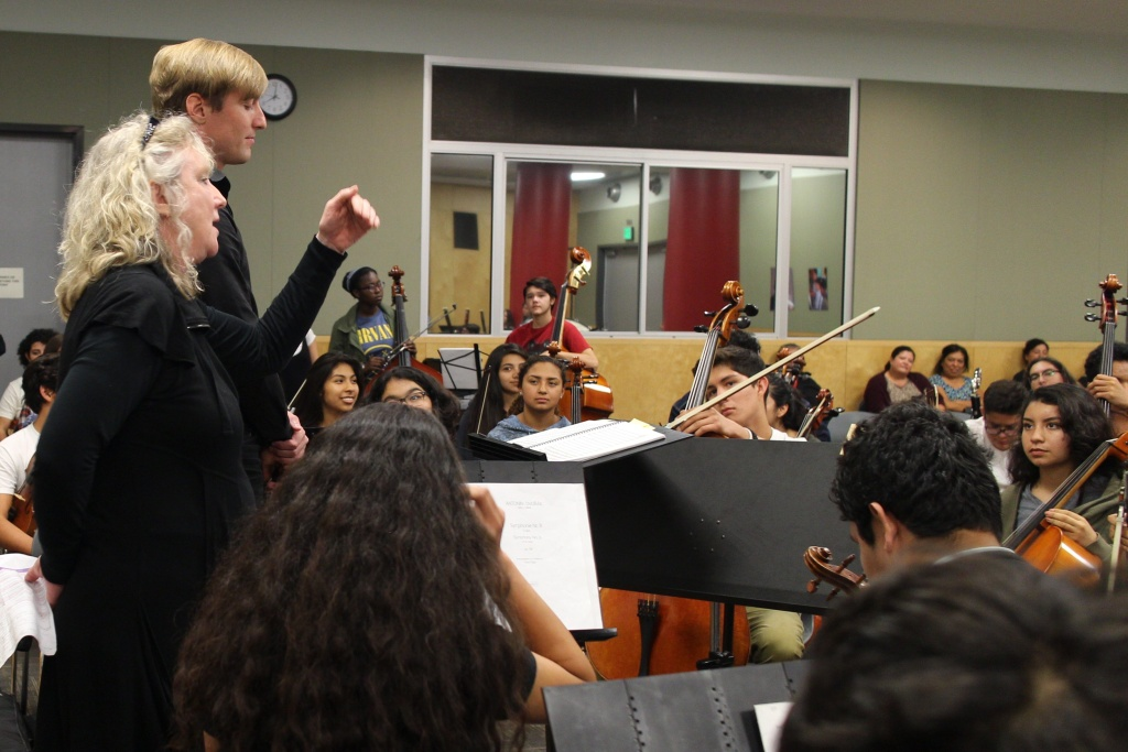 Debbie Devine, theatrical director for the LA Philharmonic, is working with the students to perfect their presence on stage to engage the audience.