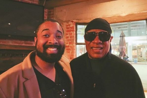 Nelson Cade III with Stevie Wonder at the Westwood restaurant Skylight Gardens