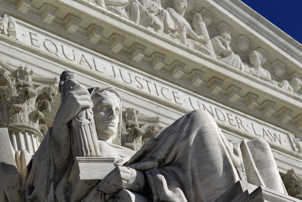 A detail of the West Facade of the U.S. Supreme Court is seen in Washington in this March 7, 2011 file photo. The justices ruled Tuesday, April 21, 2015, that natural gas traders can be sued for illegally manipulating natural gas prices more than a decade ago during California's energy crisis.
