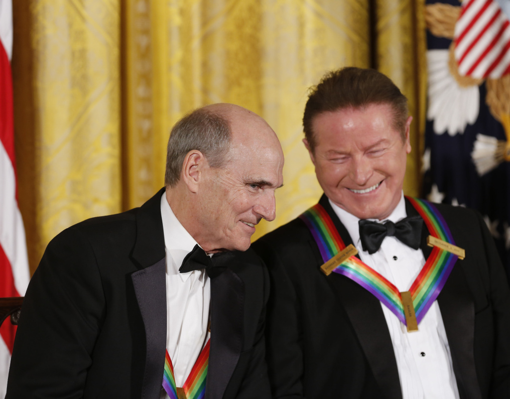 WASHINGTON, DC - DECEMBER 4: Singer James Taylor and Eagles band member Don Henley listen to President Barack Obama speak during a ceremony for the 2016 Kennedy Center honorees December 4, 2016 in the East Room of the White House in Washington, DC. The honorees include Eagles band members, actor Al Pacino, singer James Taylor, pianist Martha Argerich and singer Mavis Staples. (Photo by Aude Guerrucci-Pool/Getty Images)