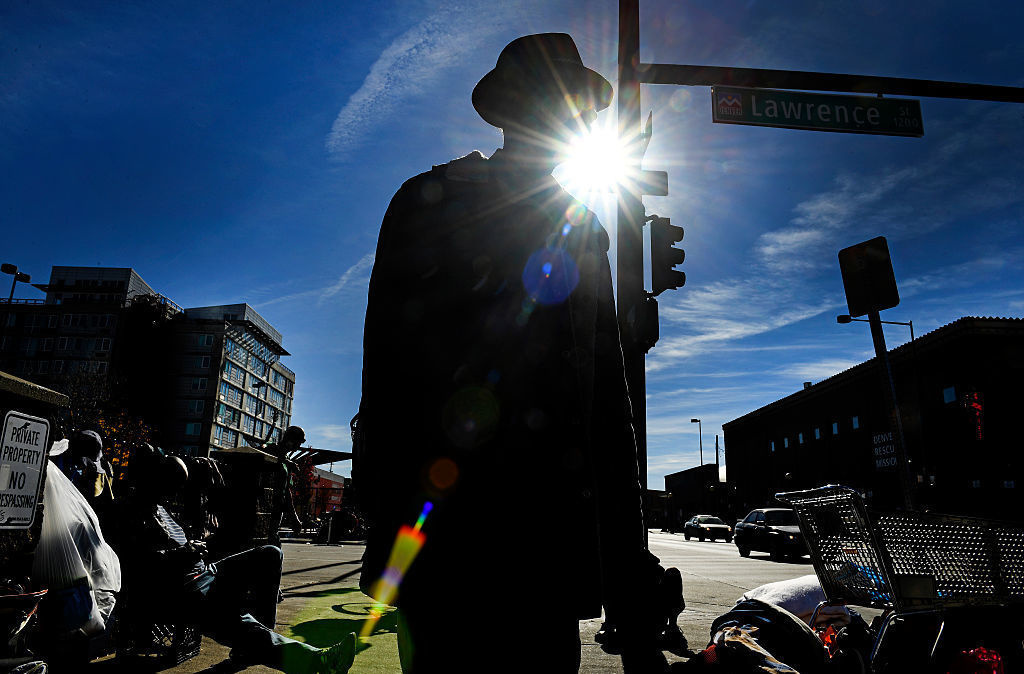 People in Denver line the sidewalks near the Denver Rescue Mission in October.
