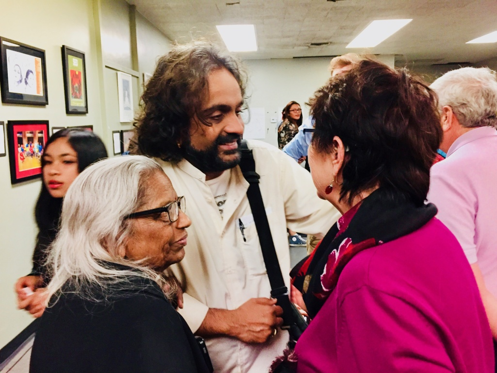 Director Shishir Kurup greets audience members after the show alongside his biggest fan, his mother, Leela, who raised him in Kenya.