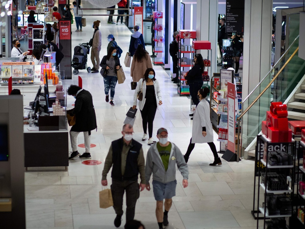 Shoppers walk through Macy's in New York on Black Friday, Nov. 27. Retail sales declined 1.1% in November, according to the Commerce Department.