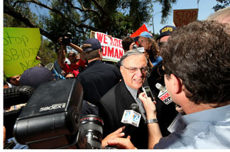 Sheriff Joe Arpaio confronts protesters and speaks with members of the media during a rally at the Rancho Bernardo Inn on August 10, 2010 in Rancho Bernardo, Calif. Arpaio, who is Sheriff of Maricopa County in Arizona, gained national attention for using deputies to conduct raids to apprehend illegal immigrants and building large outdoor prison tents to house inmates.