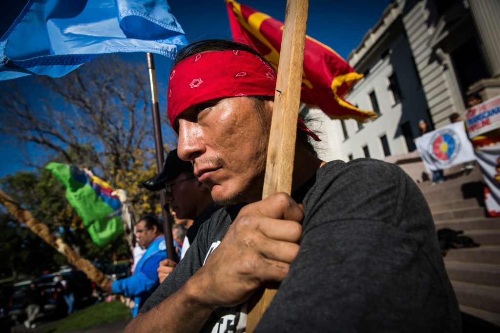 Chris Firethunder, a member of the Oglala Lakota Native American tribe, participates in a protest against the proposed Keystone XL pipeline on October 13, 2014 in Pierre, South Dakota. Numerous Native American tribes, ranchers, politicians and people against the pipeline came together to hold a rally on the steps of the state's capital building.