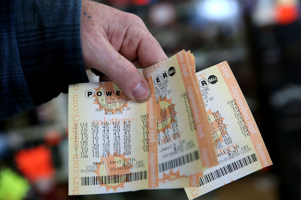Clerk who sold record jackpot just happy to have touched winning ticket