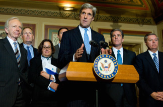 Senate Foreign Relations Chairman Senator John Kerry (C), D-MA, speaks to the media following a meeting with CEOs about climate change at the US Capitol in Washington, DC, on December 3, 2009