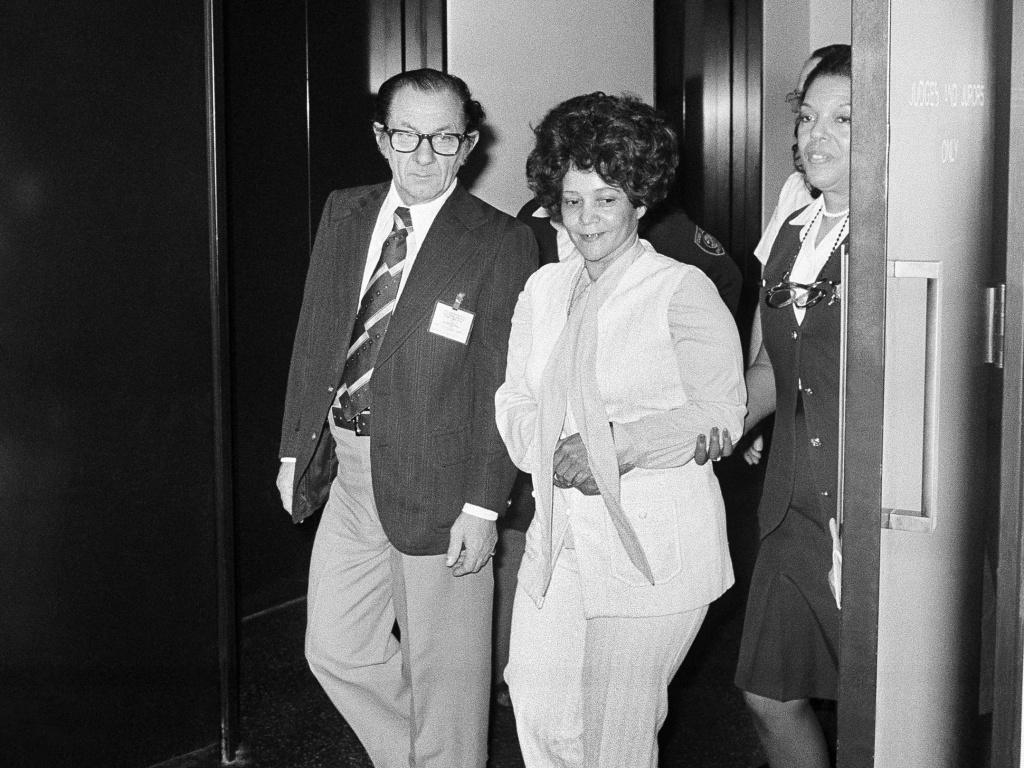 Linda Taylor, 40, walks with her attorney T. Lee Boyd as they leave the Chicago Civic Center on March 8, 1977, during a recess in her trial. Dubbed the