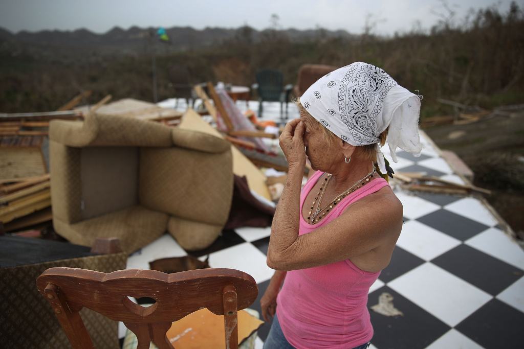 Irma Maldanado stands in what is left of her home after Hurricane Maria passed through on September 27, 2017 in Corozal, Puerto Rico.