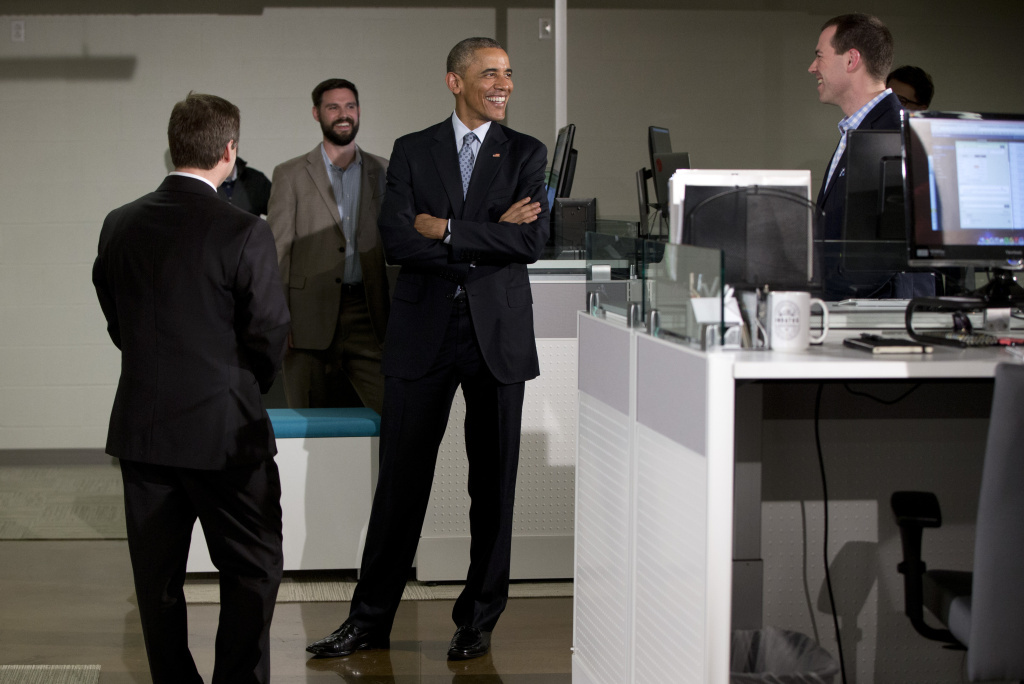 President Obama tours the Louisville-based tech company Indatus with Indatus president Philip Hawkins, left.