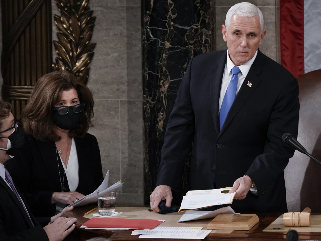 Senate parliamentarian Elizabeth MacDonough, second from left, works beside then-Vice President Mike Pence earlier this year during the certification of Electoral College ballots in the presidential election, in the House chamber of the U.S. Capitol.