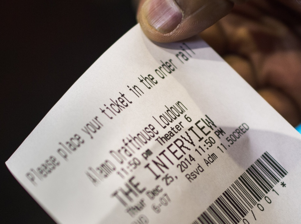 A man shows his ticket for