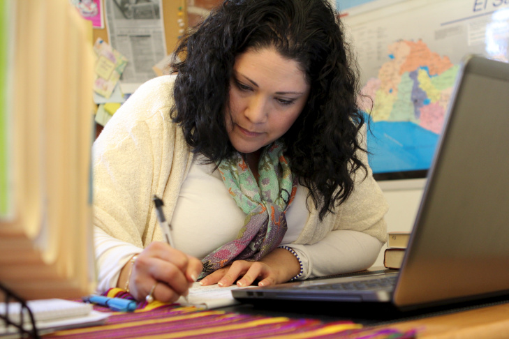 Jocelyn Duarte, a parent whose students attend Wilshire Crest Elementary in mid-city Los Angeles,  works on her call list to try and return music access to her family's school. She's spent about 40 hours making phone calls and doing research.