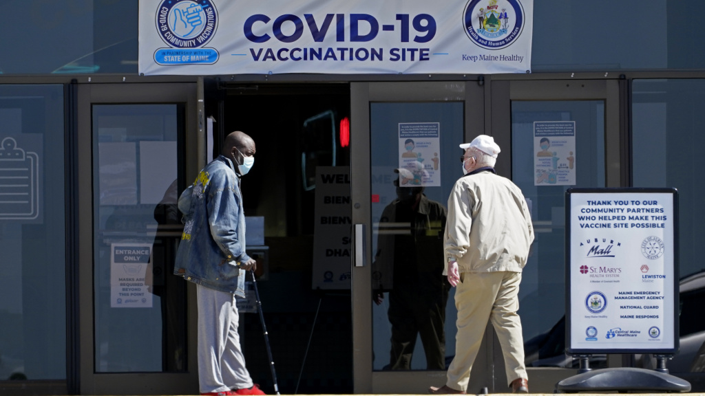 A COVID-19 vaccination clinic last month in Auburn, Maine. A drop in life expectancy in the U.S. stems largely from the coronavirus pandemic, a new study says.