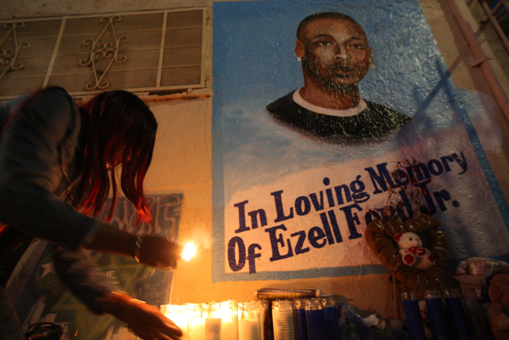 Tritobia Ford lights candles at a memorial for her son, Ezell Ford, on December 29, 2014 in Los Angeles.