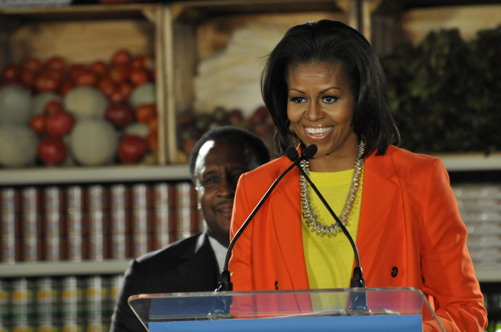 Michelle Obama addressed a room full of local politicians, press and community members in support of the FreshWorks program. The first lady is currently in China, where her style is generating buzz.