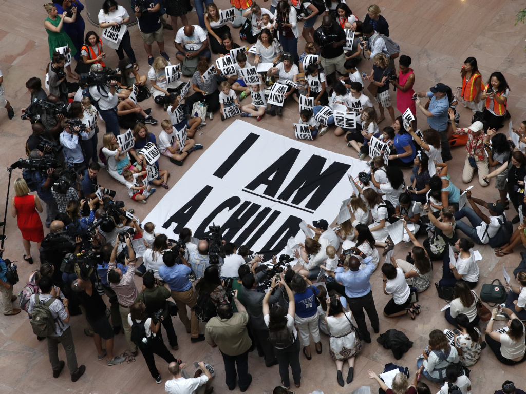 Families with young children protest the separation of immigrant families with a sit-in at the Hart Senate Office Building in Washington last week.