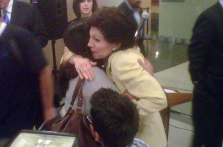 Donor Marion Anderson hugs friends and patients at the new Children's Hospital Los Angeles facility named in her and her husband's honor.