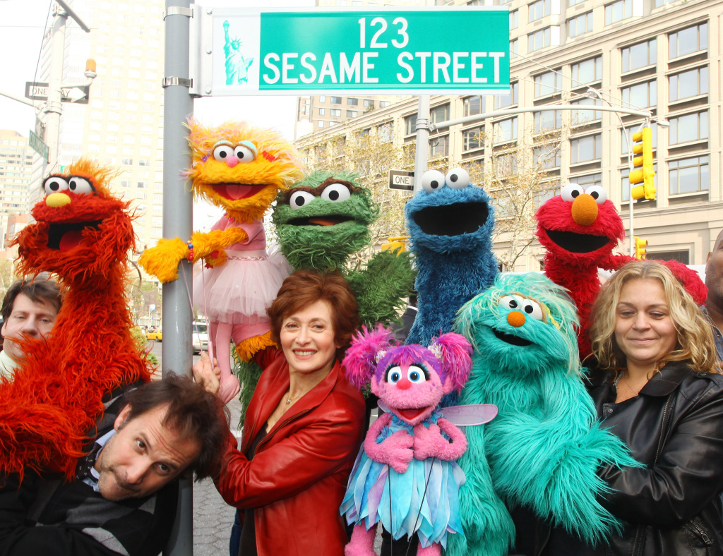 Sesame Street characters pose under a
