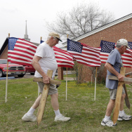 Bob Butler, left, and Bob Gordon, right, work on a memorial on Thursday at Central Christian Church for the victims of the Fort Hood shooting in Killeen, Texas.