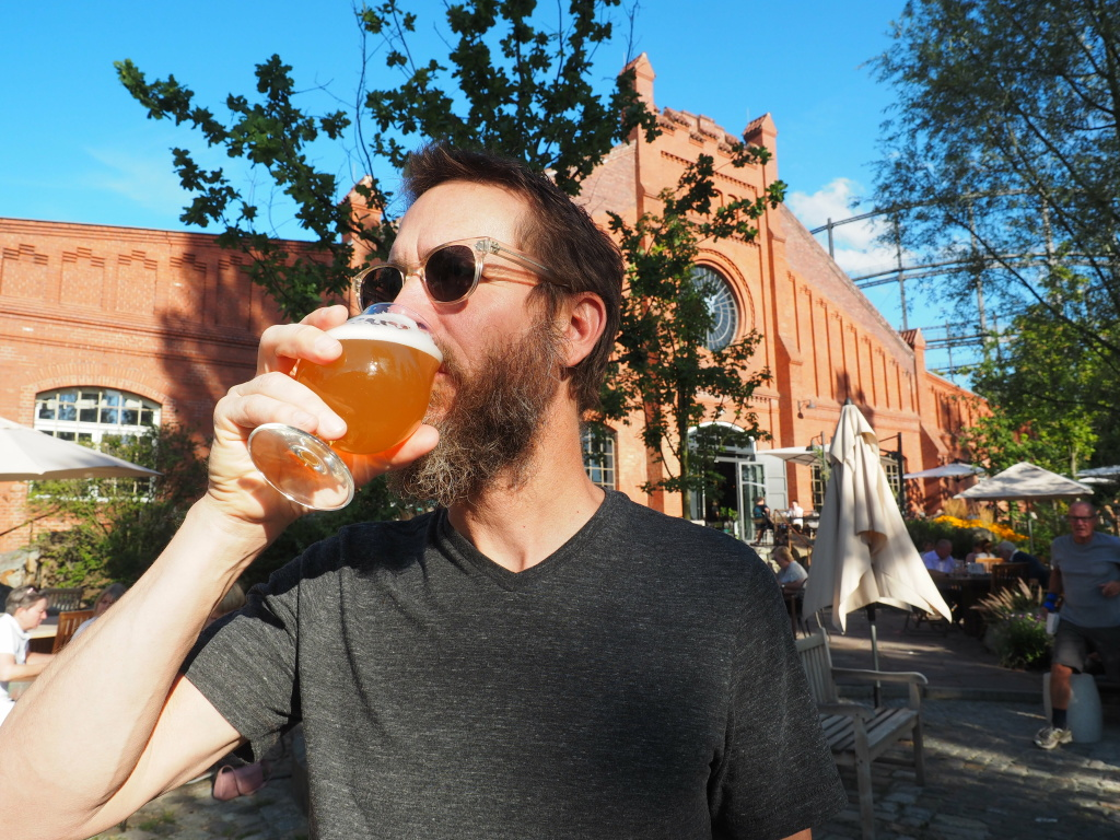 Stone Brewing co-founder and chairman Greg Koch gulps down a beer.