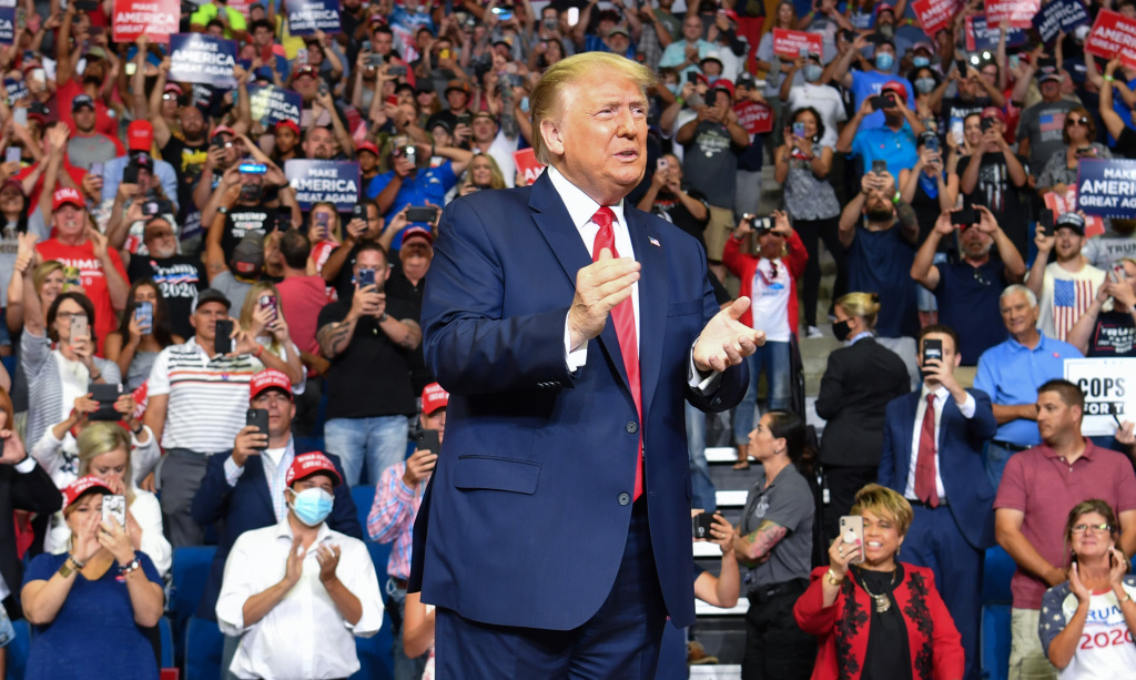 President Trump steps back onto the campaign trail to rally supporters Saturday in Tulsa, Okla.