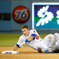Ruben Tejada #11 of the New York Mets is hit by a slide by Chase Utley #26 of the Los Angeles Dodgers in the seventh inning at Dodger Stadium on October 10, 2015.