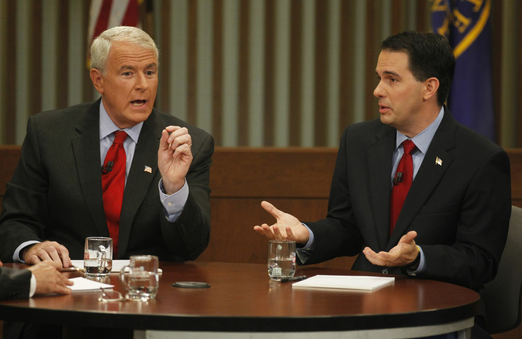 Republican Wisconsin Gov. Scott Walker, right, and Democratic challenger Tom Barrett participate in a televised debate Thursday, May 31, 2012, in Milwaukee.